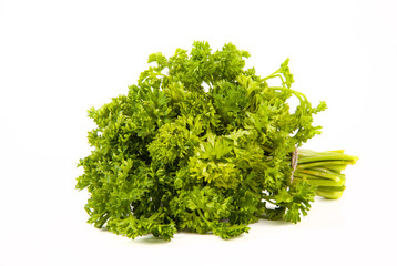 bunch of parsley tied up twine on a white background