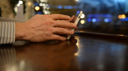 Close-up of male hands with tablet computer a cup of coffee