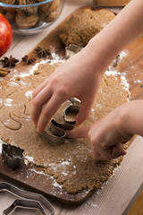 Close up little hands making the gingerbread cookies