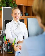 Positive female doctor discharging patient