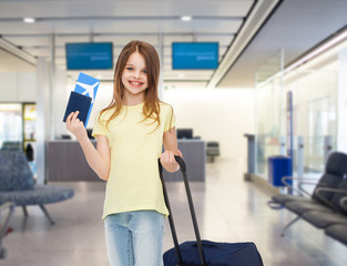 smiling girl with travel bag ticket and passport