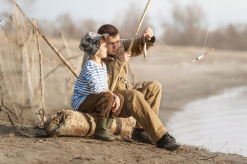 Boys fishing on the river
