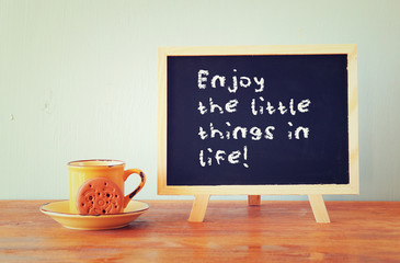 blackboard with the phrase enjoy the little things in life next