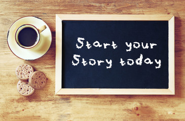 top view of blackboard with the phrase start your story today ne