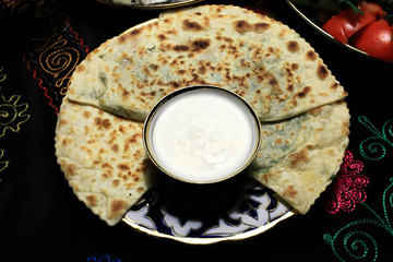 Qutab with sauce on a plate