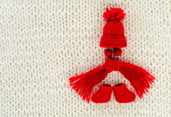 Red cap, scarf, boots and beads in the form of a knitted toy