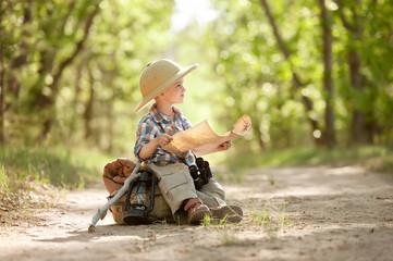 Boy traveler exploring route map