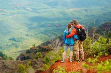 Two hikers enjoying the view from the mountain top