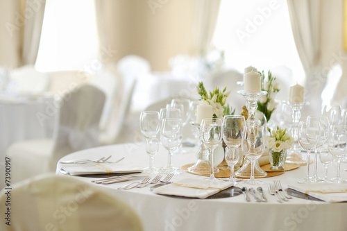 Table set for an event party or wedding reception - 73900917