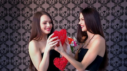 Lesbian women kissing in erotic foreplay game