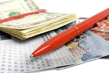 Credit card, pen and money closeup
