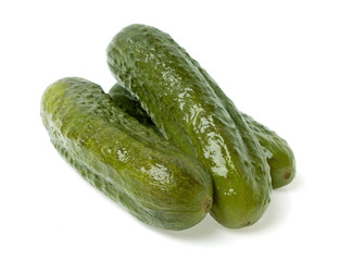 Pickled cucumbers on white background