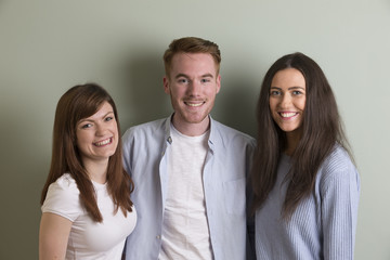 Portrait of 3 happy young people.