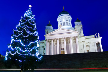 Famous Helsinki Cathedral with Christmas tree at twilight