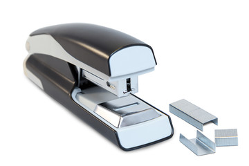 Closeup of a grey office stapler and staples, isolated on white