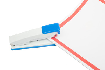stapler with paper lies on a white background