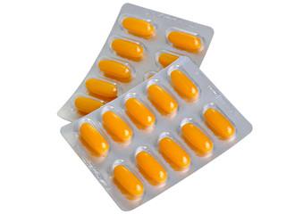 Yellow capsule pills in blister