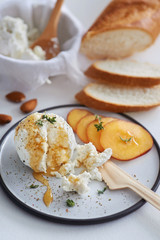 Ricotta cheese appetiser with honey and nectarine