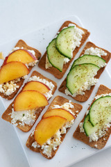 Cottage cheese canapes with peach and cucumber
