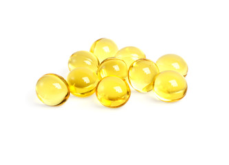 Cod liver oil omega 3 gel capsules on a white background