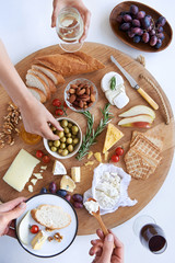 Cheese board with hands, party snacks appetiser platter