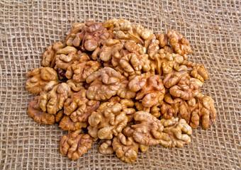 Walnuts on burlap background