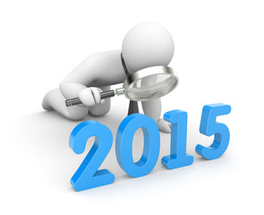 Businessman examine 2015 word