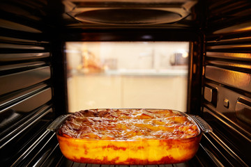 Dish Of Lasagne Cooking Inside Oven