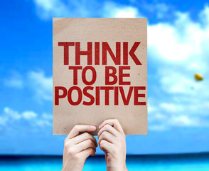 Think To Be Positive card with a beach on background