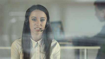 The young woman work in the modern call center