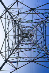 Looking up metal electricity pylon