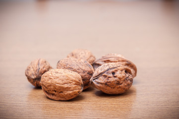 Some walnuts on a table. Vintage style