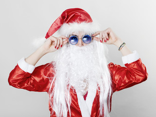 Transgender Santa Claus wearing sunglasses
