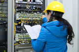 woman connecting network cables to switches