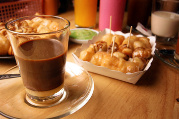 hot coffee with milk in the glass,asian traditional coffee.