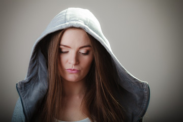 Portrait of teen girl in hooded sweatshirt