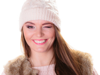 Happy woman in winter clothes winking