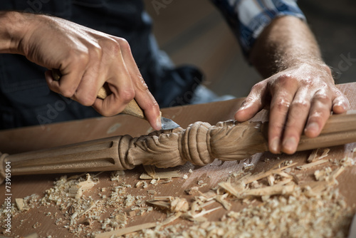 Carpenter at work - 73915904