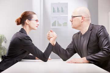 woman vs man business arm wrestling