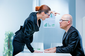 business woman shouting against a man