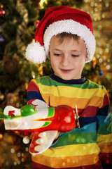portrait of a happy little boy holding a new gift. boy in a hat