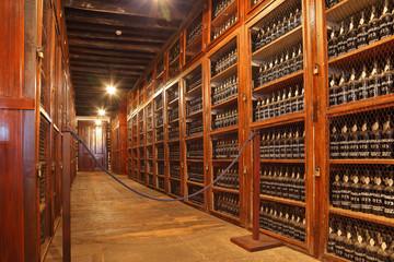 Long rows of shelves made of mahogany