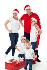Happy cute family in santa's hats