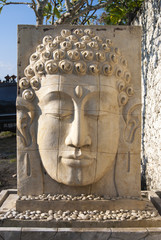 Face relief of Buddha on white stone