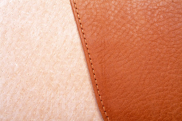 Brown leather label with seam