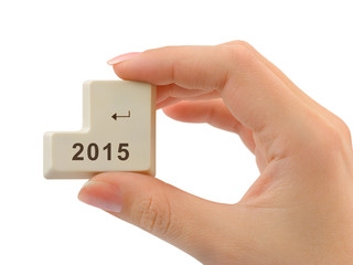 Computer button 2015 in hand