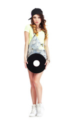 Portrait of Woman in Kepi and Jeans with Vinyl Record