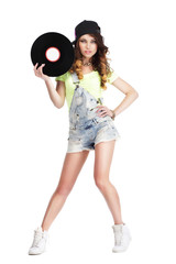Artistic Woman in Jeans showing Retro Vinyl Record