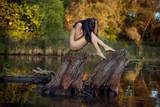 Naked girl on the lake.