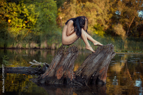 Deurstickers Fantasie Landschap Naked girl on the lake.